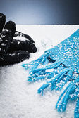 Gloves and a scarf over the snow — Stock Photo