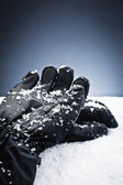 Gloves over the snow — Stock Photo
