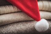 Wool sweaters and Christmas hat — Stock Photo
