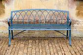 Iron bench against Bath stone building — Stock Photo
