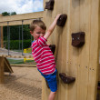 Boy on playground climbing wall — Stock Photo