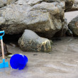 Childs bucket and spade on a beach — Stock Photo