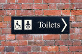 Sign showing disabled toilet and baby change room — Stockfoto