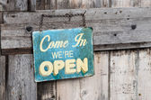 Vintage open sign on old wooden door — Stockfoto