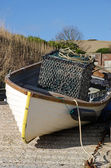 Small fishing boat with crab pot — Stock Photo