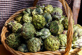 Artichokes in a handmade basket — Stock Photo