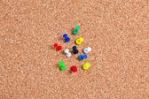 Group of Thumbtacks Pinned on Corkboard — Stock Photo