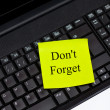 Yellow Dont Forget Note on Notebook, Laptop — Stock Photo