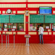 Passenger buying rail ticket from the ticket window. — Stock Photo