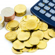 Stock Photo: Calculator and coins stack