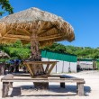 Relax corner with wooden umbrella on the beach in holiday — Stock Photo