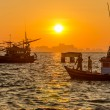 Sunrise with fishing boat at Na Ban Pier — Stock Photo