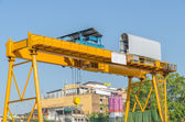 Industrial construction crane are operating over blue sky — Stock Photo