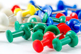 Close-up colorful push pins — Stock Photo