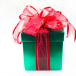 Green box red bow and ribbon — Stock Photo