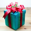 Green box red bow and ribbon — Stock Photo #36011351
