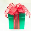 Green box red bow and ribbon — Stock Photo #36011867