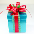 Green box red bow and ribbon — Stock Photo #36011947