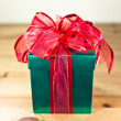 Green box red bow and ribbon — Stock Photo #36012065