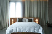 Bed in a hotel room — Stock Photo