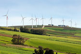Wind turbines on hilly expanse — Stock Photo