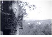 The stone cross near the Bran's castle in Romania — Stock Photo