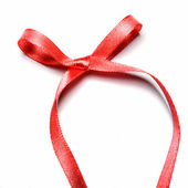 Shiny red satin ribbon and bow on white background — Stok fotoğraf