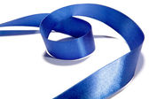 Blue fabric ribbon and bow on white background — Stockfoto