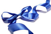 Blue fabric ribbon and bow on white background — Stock Photo