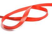 Shiny red satin ribbon on white background — Stock Photo