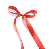 Shiny red satin ribbon and bow on white background — Stock Photo
