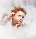 The beautiful little boy in an image of an angel — Stock Photo
