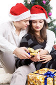 Happy young couple, in a New Year's situation — Stock Photo
