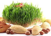 East sweets with Novruz grass — Stock Photo