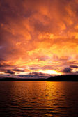 Dramatic fire red sunset over a lake — Stock Photo