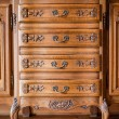 Antique wood carved chest of drawers — Stock Photo #31414251