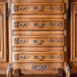 Antique wood carved chest of drawers — Stock Photo