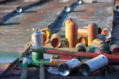 Used spray cans in a roof — Stock Photo