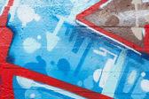 Graffiti zbliżenie z strzałki i niebieskich kropek — Zdjęcie stockowe
