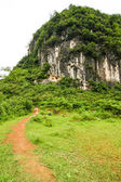 Path leading to karst mountain — Stock Photo