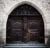Big dark brown wooden door — Stock Photo