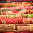 Folded pile of handmade textiles india — Стоковая фотография
