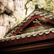 Stock Photo: Details of old chinese house roof