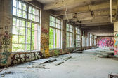 Big windows in old abandoned factory hall — Stock Photo