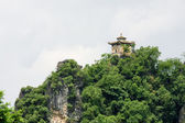 Pavilion on top of limestone peak — 图库照片