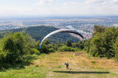 Paraglider running for take off — Stock Photo