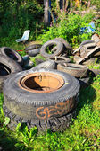 Heap of used tires on junkyard — Stock Photo