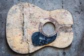 Broken acoustic guitar — Stock Photo