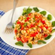 Stock Photo: Scrambled eggs with tomato, ham, bell pepper