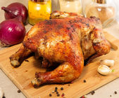 Whole baked chicken with a crispy golden crust — Stock Photo